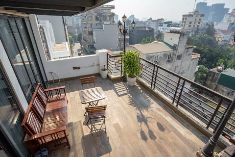 Lake view apartment with 2 bedrooms and a huge balcony for rent on To Ngoc Van street, Tay Ho